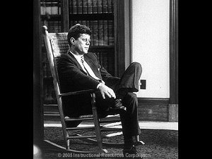 35th President of the United States, John F. Kennedy sitting in a rocking chair.