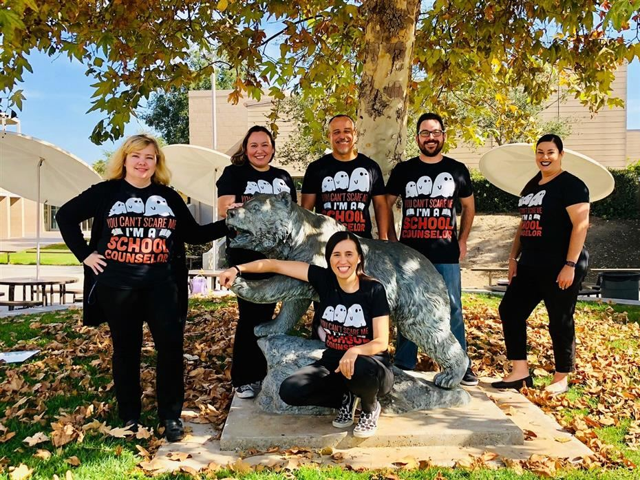 "Image of Counselors Posing in Shirts that Read ""You can't scare me, I'm a high school counselor."""