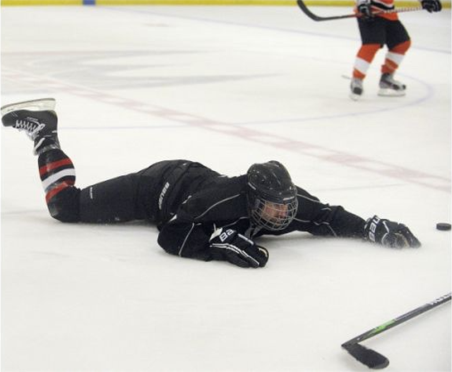 "Mr. Yusi ""playing"" hockey... (This photo was in the Orange County Register!)"