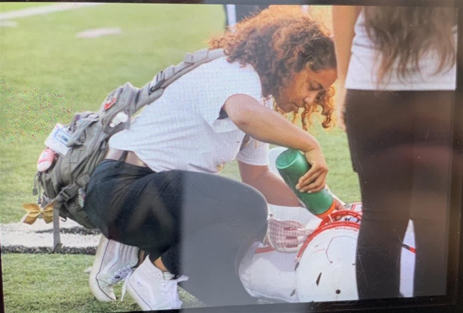 This picture is me helping a football player